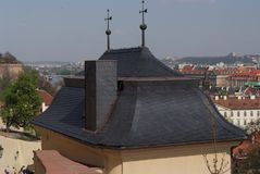Roof against the panorama of the city. Prague, Czech Republic royalty free stock images