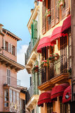 Picturesque row of houses with typical Spanish balconies near the market place in Palma de Mallorca, Spain Royalty Free Stock Image