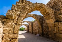 Picturesque ruins of the ancient city of Caesarea. Israel. Sunny spring day. Arched passage - covered street of Port of Caesarea. Concept of ecological and Royalty Free Stock Image