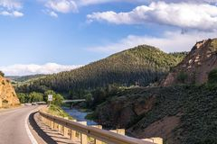 Picturesque rural highway. Journey to the Rocky Mountain National Park Royalty Free Stock Image