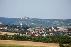 Picturesque rural landscape in Austria. Picturesque rural landscape in area of Mistelbach, Niederosterreich, Austria. Ruins of Falkenstein castle in the distance Royalty Free Stock Photos