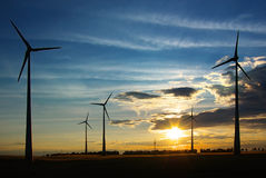 Picturesque rural landscape with wind turbines. Royalty Free Stock Image