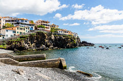 A picturesque scene at the beach with boats and houses on Madeir. This picture was taken on Madeira Stock Photo