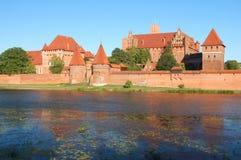Picturesque scene of Malbork castle on Nogat river, Poland Stock Photo