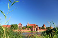 Picturesque scene of Malbork castle on Nogat river, Poland Royalty Free Stock Photos
