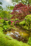 Picturesque Scenery of Japanese Garden with Asian Zen Sculptures Stock Images