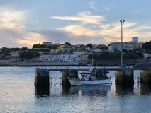 Sea and city view with single boat in Porto portgal royalty free stock photo