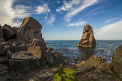 Picturesque sea landscape with rocky shore. Royalty Free Stock Image