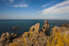 Picturesque sea landscape with rocky shore. Stock Image
