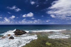 Picturesque sea landscape with rocky shore. Royalty Free Stock Images