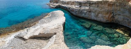 Grotta del Canale, Sant`Andrea, Salento sea coast, Italy. Picturesque seascape with white rocky cliffs, caves, sea bay and islets at Grotta del Canale, Sant` stock photo
