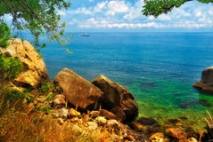 Picturesque seashore with a ship on the horizon. Picturesque seashore in the tropics with a ship on the horizon Royalty Free Stock Images