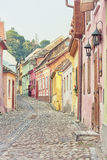 Picturesque Sighisoara street, toned image. Stock Images