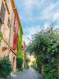 Picturesque small alleyway in Antibes, Cote d`Azur, France Royalty Free Stock Photos