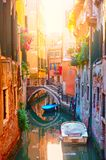 Picturesque small canal with bridge and boats in Venice. In the evening, Italy royalty free stock images