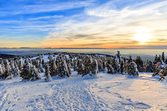 Picturesque snowy landscape at sunset Stock Photos