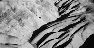 Picturesque soft waves from multi-coloured sandstone. Death valley, Zabriski. A point on a sunset royalty free stock image