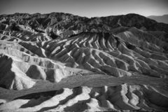 Picturesque soft waves from multi-coloured sandstone. Death valley, Zabriski. A point on a sunset stock photo