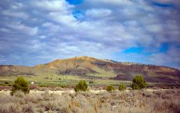 Picturesque south landscape with mountains stock photos