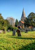 Quaint English village church  (St James) in Shere, Surrey. Stock Photo