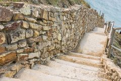 Picturesque steps with stone fence descending to the sea Stock Photo