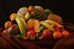 Picturesque stilllife of fruits. Opulent composing of different fruits Stock Images