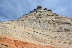 The picturesque stone cliff on the background of blue sky Stock Photography