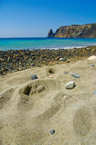 Picturesque stony beach. Scenic view of picturesque stony beach with sand in foreground Stock Photo