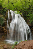 Picturesque stream of falling water Stock Images