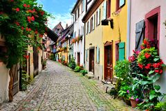 Picturesque street in Alsace, France. Picturesque street in the of the town of Eguisheim, Alsace, France Stock Photography