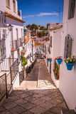 Picturesque street of Mijas. Charming white village in Andalusia Stock Photos