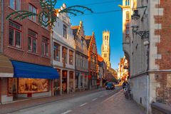 Picturesque street and tower Belfort in Bruges Royalty Free Stock Photo
