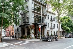 Picturesque street view in Greenwich Village, New York. New York City, USA - June 22, 2018: Fashionable restaurant in the corner of Gay Street with Christopher Stock Image