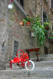 Picturesque street view Tuscany. Nice picturesque street in Tuscany with small red bicycle at the front Royalty Free Stock Photos