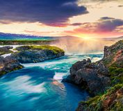 Picturesque summer morning scene on the Godafoss Waterfall. Colorful sunrise on the on Skjalfandafljot river, Iceland, Europe. Artistic style post processed stock photo