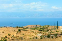 Sicily coast landscape, Reggio Calabria, Italy. Picturesque summer view to sea and Sicily island in far from mountain hills in Motta San Giovanni outskirts Royalty Free Stock Images
