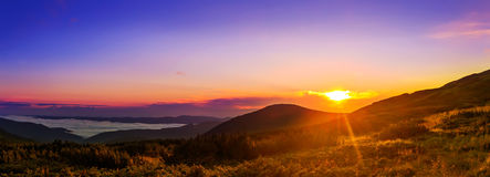 Picturesque sunrise, morning dawn in Carpathian mountains, panorama, Ukraine. stock image