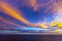 Picturesque sunrise over the Atlantic ocean. Panoramic view of the beautiful and dramatic celestial dawn, background stock photography