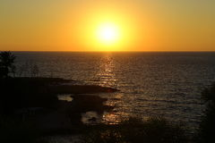 Picturesque sunset on the coast of the Mediterranean sea, Cyprus Stock Photos