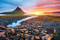 The picturesque sunset over landscapes and waterfalls. Kirkjufell mountain. Iceland royalty free stock photos