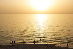 A picturesque sunset of peach colour on the beach royalty free stock image