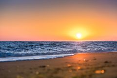 Picturesque sunset at the seaside on beach Stock Photography