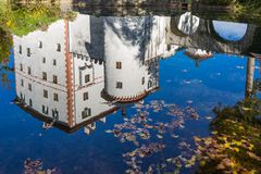 Sneznik Castle reflecting in the pond. The picturesque 13th-century Sneznik Castle Grad Snežnik, Schloß Schneeberg reflecting in the pond, located in Loška Stock Photos