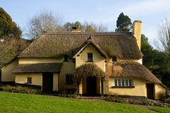 English Thatched Cottage Selworthy Somerset. A picturesque thatched cottage in the village of Selworthy, Somerset, in Exmoor National Park royalty free stock image