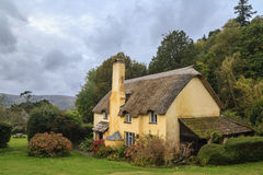 Picturesque Thatched roof cottage in Selworthy. Thatched roof cottage in Selworthy village Somerset Royalty Free Stock Photo