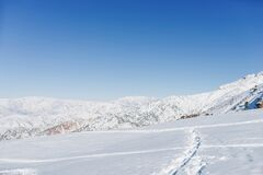 Picturesque Tien Shan mountains in Uzbekistan, partially covered with snow, winter clear Sunny day in the mountains