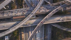 Picturesque top aerial drone panorama flight over busy highway multiple vehicle road with traffic cement junction bridge. Fascinating top aerial drone panorama stock footage