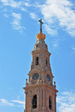The picturesque tower, topped by a cross stock photography