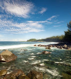 Picturesque tropical coastline. Scenic view of River Langevin flowing out on tropical coastline, Reunion Island Royalty Free Stock Image