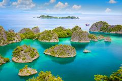 Picturesque tropical lagoon of  islands with reef coastline  and turquoise water stock photo
